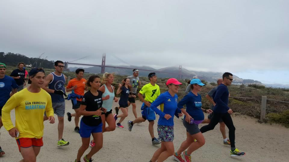 leading a shake-out run in advance of The San Francisco Marathon's 5k race in 2015 (36 weeks/9 months pregnant)