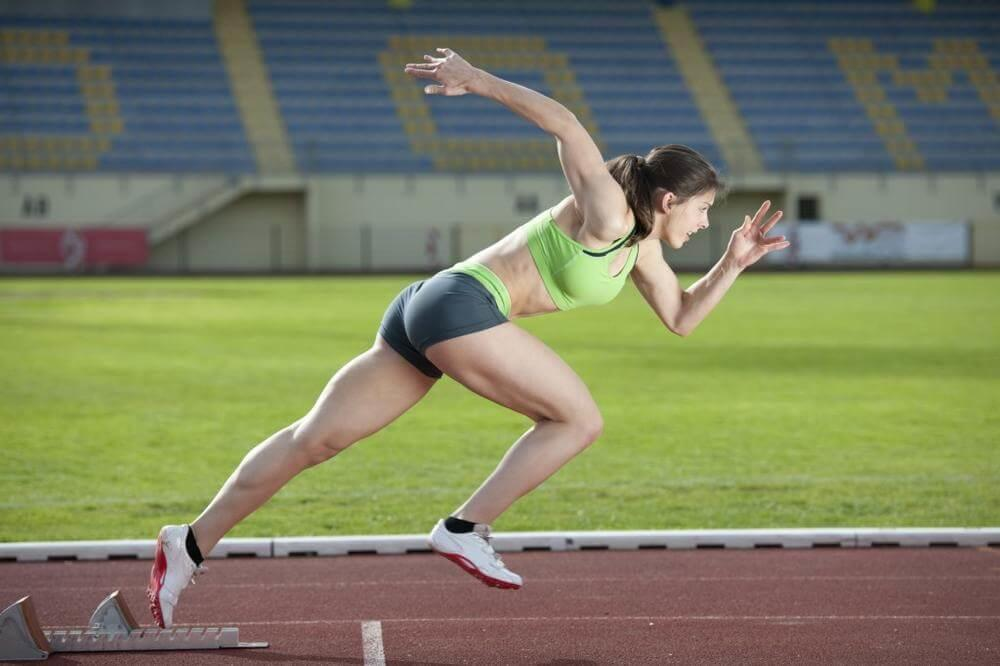 woman taking off in sprinting