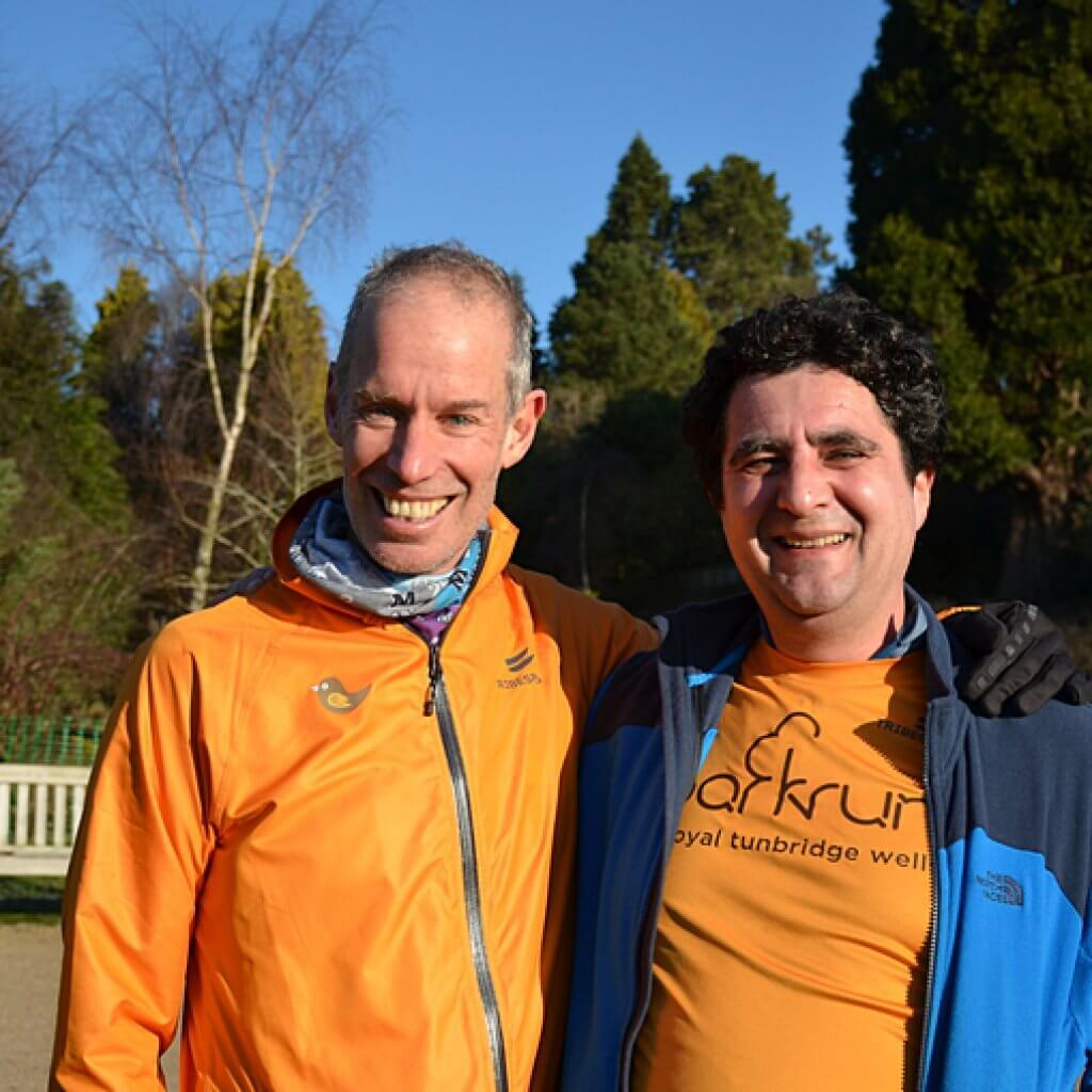 parkrun founder Paul Sinton-Hewitt (left) with a fellow parkrunner.