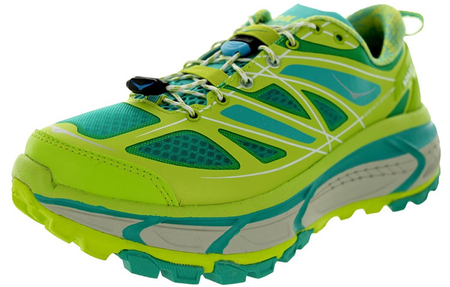 A three quarter perspective of the Hoka One One Mafate Speed Yellow
