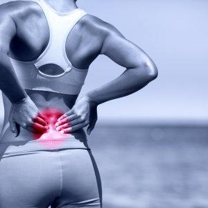 female runner suffering from lower back pain
