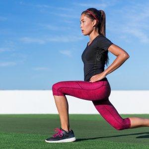 woman in athletic gear doing kneeling lunge