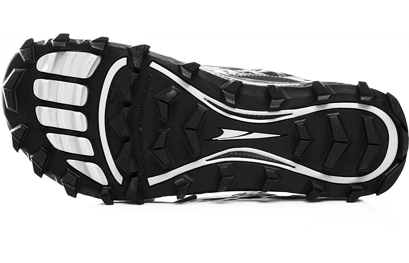 The aggressive outsole provides traction on rugged terrain