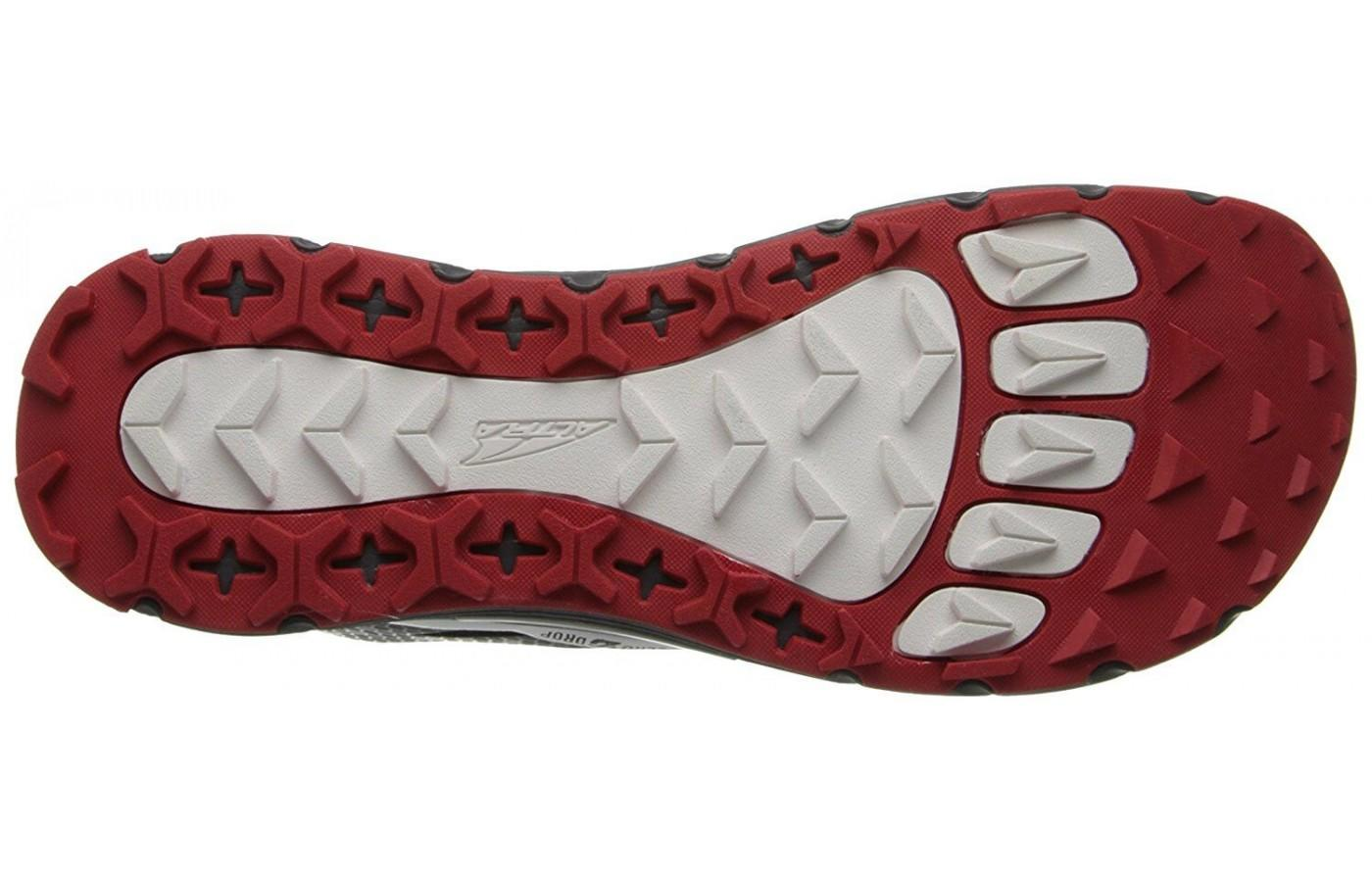 The outsole is designed to grip the trail and provides excellent traction.