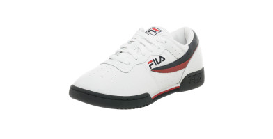 Retro-looking sneaker has a leather upper with ventilation perforations.