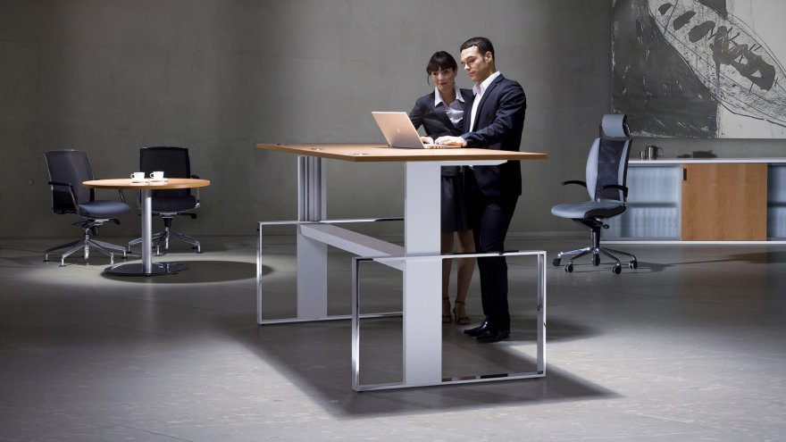 Considering a standing desk? Check out the pros and cons to gauge if it's right for you.