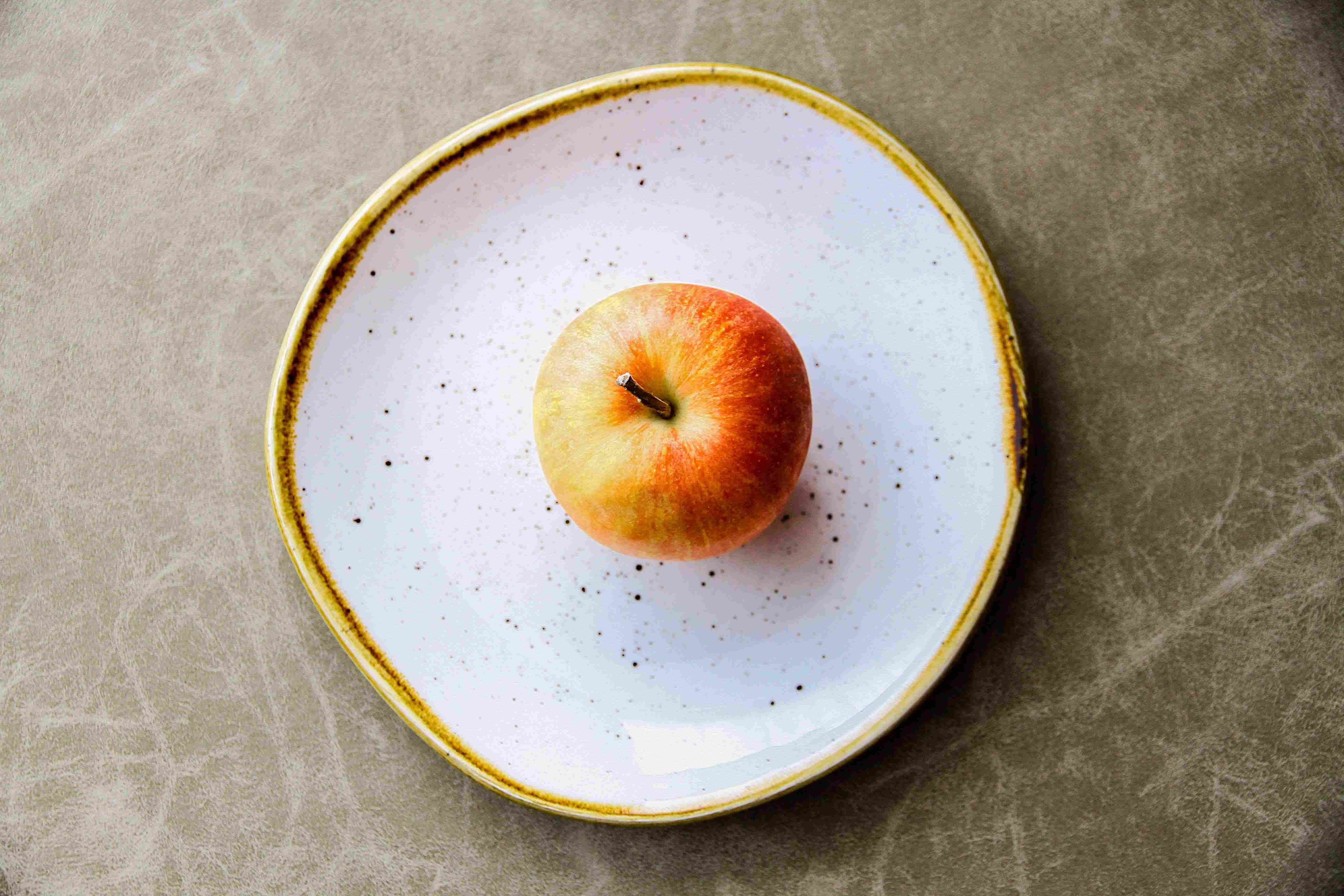 a single apple on a plate