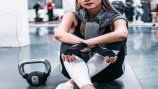 Ways to get more comfortable at the gym inlcude taking a class or working out with a personal trainer.