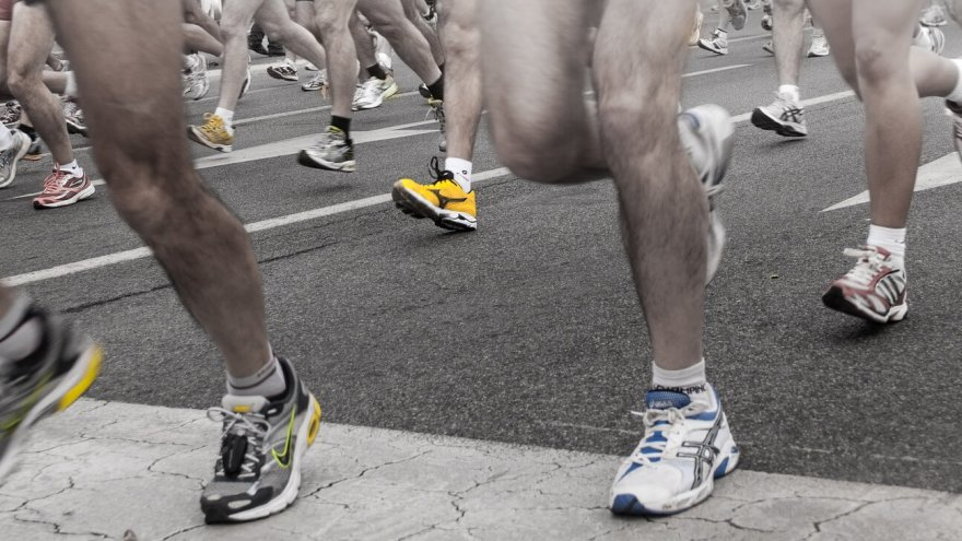Should you race in your training shoes or splurge for a pair of racing shoes? Read on to find out.