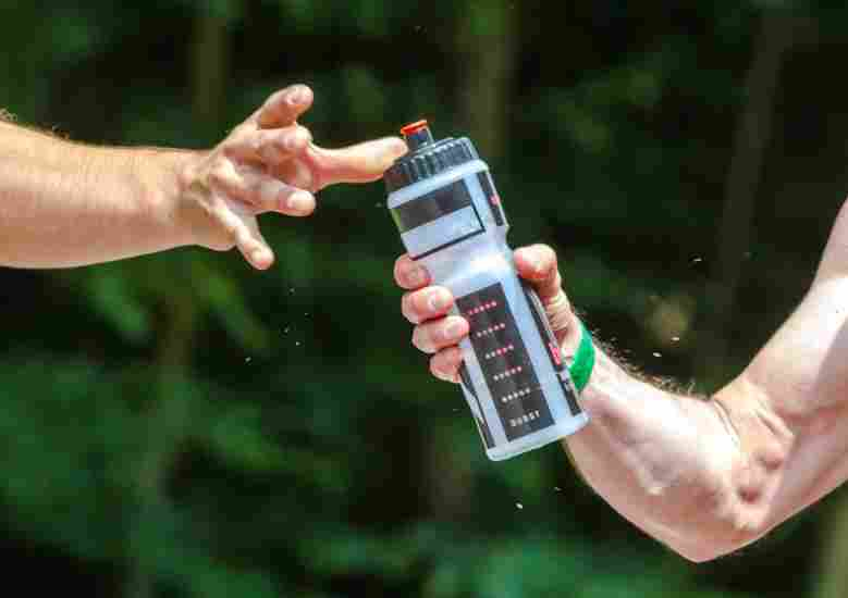 The best ways to carry water during a run inlcudes hydration vests for long runs and handheld bottles for short ones.
