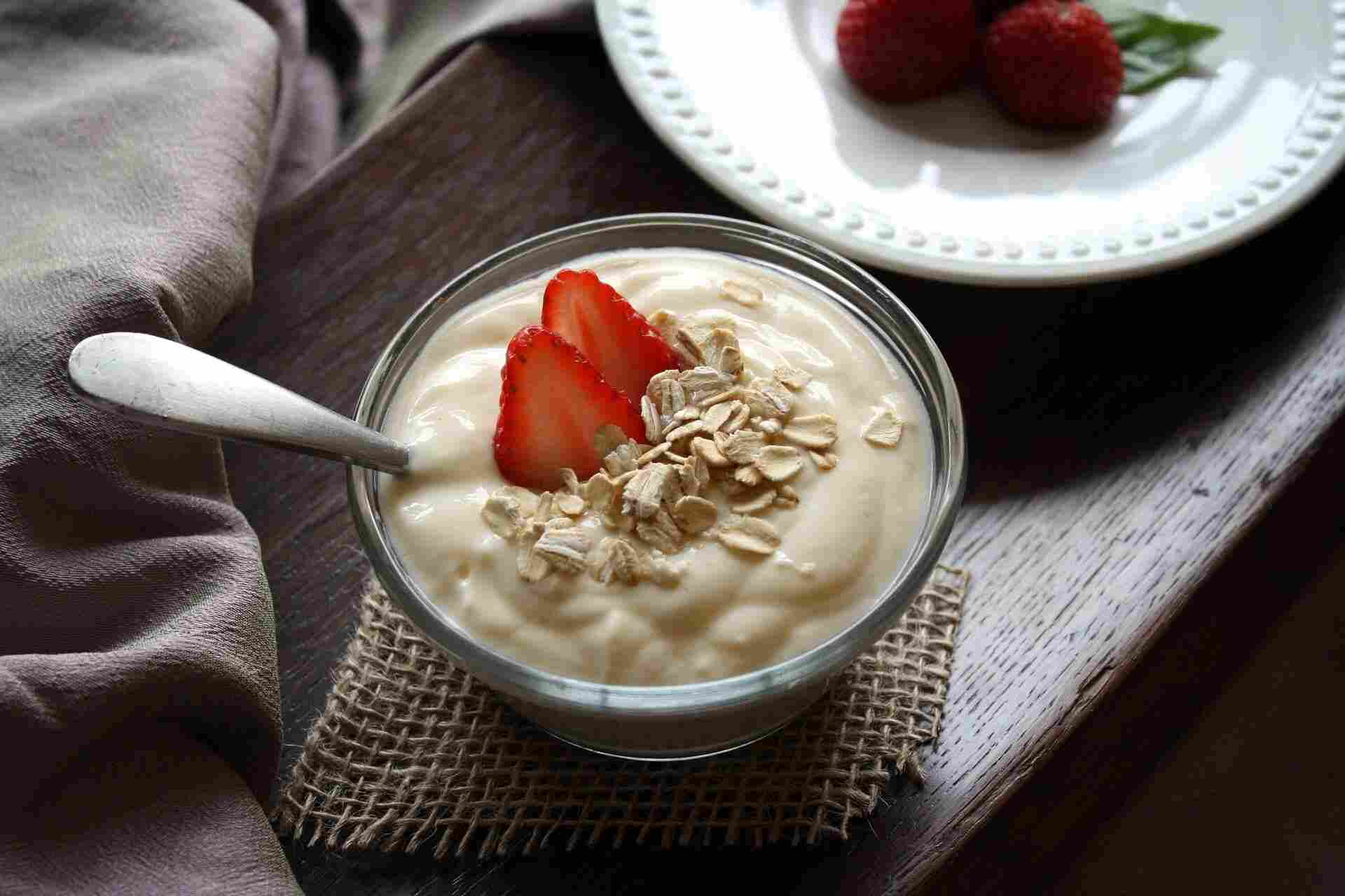 a bowl of yogurt and strawberries